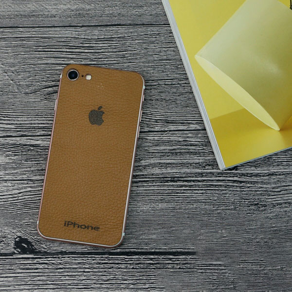 Miếng dán da iPhone 7 khắc logo da bò 100%